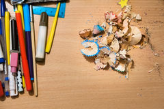 Colored pencils and shavings on the table. And light Stock Images