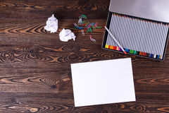 Colored pencils. Sheet of paper. The jammed paper. Top view Royalty Free Stock Photography