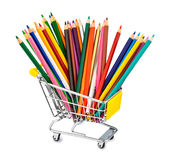 Colored pencils in shopping cart Royalty Free Stock Photography