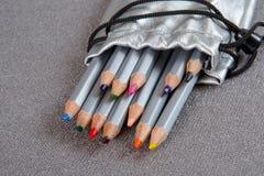 Colored pencils in a silver case Stock Photos