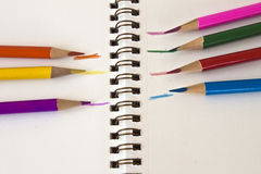 Colored pencils and sketch pad Stock Image