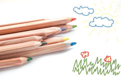Colored pencils and sketch pad Royalty Free Stock Image