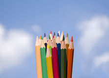Colored pencils. With sky background Royalty Free Stock Photos