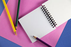 Colored pencils with small notebook Royalty Free Stock Photo