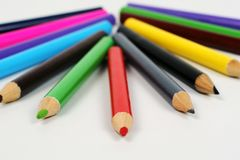 Colored pencils. Spectrum of round colored wood pencils Royalty Free Stock Photos