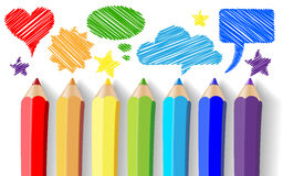 Colored pencils and speech bubbles Royalty Free Stock Photo