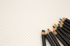 Colored pencils and squared paper, return to the old ways of drawing and coloring concept royalty free stock photo