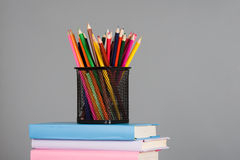 Colored pencils and a stack of books Stock Photo