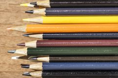 Colored pencils stacked in a box Royalty Free Stock Photos