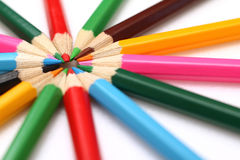 Colored pencils stacked in the form of the sun Stock Photo