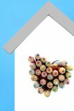 Colored Pencils Are Sticking Out From The Heart Shaped Window Royalty Free Stock Photos
