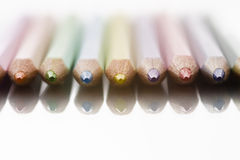 Colored pencils on straight line Stock Photos