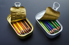Colored pencils in tins Royalty Free Stock Photo