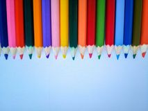 Colored pencils at the top on a white background stock images