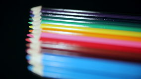 Colored Pencils. Translation Focus. Colored Pencils Lie on a Black Table. Translation of Focus stock video footage