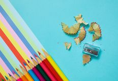 Colored pencils, trash and rainbow colorful stripes stock photos