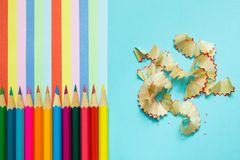 Colored pencils, trash and rainbow colorful stripes royalty free stock images