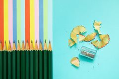 Colored pencils, trash and rainbow colorful stripes stock image