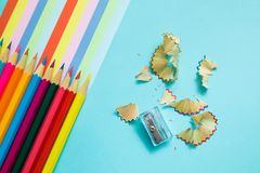 Colored pencils, trash and rainbow colorful stripes stock images