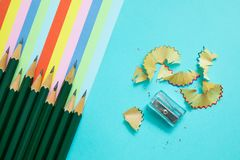 Colored pencils, trash and rainbow colorful stripes royalty free stock photo
