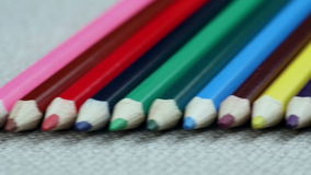 Colored Pencils Twelve Pieces Lie on White Cloth stock video