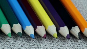 Colored Pencils Twelve Pieces Lie on White Cloth stock video footage