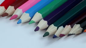 Colored Pencils Twelve Pieces Lie on White Paper stock footage