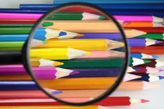 Colored pencils under loop - careful choice of color Royalty Free Stock Images