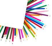 Colored pencils under a sheet of paper Royalty Free Stock Image