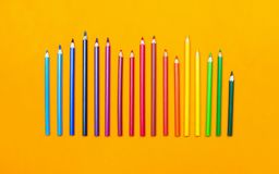 Colored pencils of various size in rainbow order vector illustration