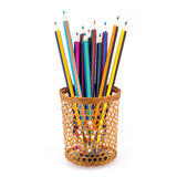 Colored pencils are visible through a wicker glass Royalty Free Stock Image