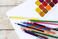 Colored pencils, water colors and paper Royalty Free Stock Photography