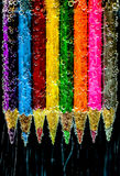 Colored pencils in water Stock Images