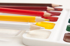 Colored pencils and watercolor paints Royalty Free Stock Photos