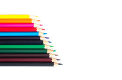 Colored pencils on white background Royalty Free Stock Images