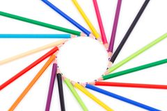 Colored pencils on white background arranged in a circle Royalty Free Stock Photography