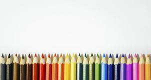 Colored pencils on white background. Close-up, copy-space for text royalty free illustration