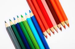 Colored pencils on white background. Close-up. Cold and warm colors stock illustration