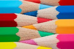 Colored pencils on white background royalty free stock image
