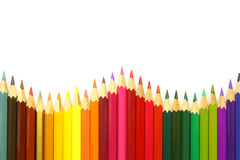 Colored pencils on white background Stock Photos