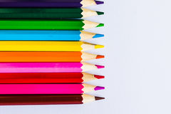 Colored pencils on white background, left. Colored pencils on white background, close Royalty Free Stock Photo