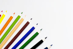 Colored pencils on a white background. School color pencils lie on a white background Royalty Free Stock Photo