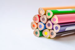 Colored pencils on white background. Set of colored pencils isolated against the white background. Close up, back side, right to left, space for text, selective Royalty Free Stock Images
