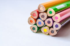 Colored pencils on white background. Set of colored pencils isolated against the white background. Close up, back side, right to left, space for text, selective Stock Photo