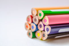 Colored pencils on white background. Set of colored pencils isolated against the white background. Close up, back side, right to left, space for text, selective Royalty Free Stock Photo