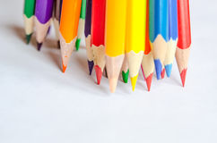 Colored pencils on white background. Set of colored pencils isolated against the white background. Close up, left to right, selective focus Royalty Free Stock Photography
