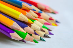 Colored pencils on white background. Set of colored pencils isolated against the white background. Close up, left to right, selective focus Stock Photo