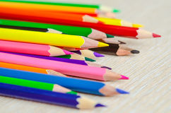 Colored pencils on white background. Set of colored pencils isolated against the white background. Close up, left to right, selective focus Stock Photography