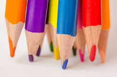 Colored pencils on white background. Set of colored pencils isolated against the white background. Close up, left to right, selective focus Stock Image