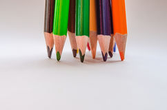 Colored pencils on white background. Set of colored pencils isolated against the white background. Close up, left to right, selective focus Royalty Free Stock Images